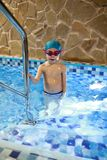 Child in swimming pool. Portrait of child in the swimming pool royalty free stock image