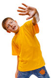 Portrait child teen frightened boy in yellow shirt Royalty Free Stock Image