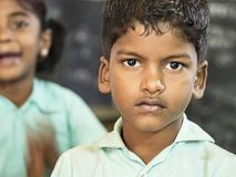 Portrait of a child teenager boy with sad expression. Loneliness poverty concept. PUDUCHERRY, INDIA - DECEMBER Circa, 2018. Portrait of unidentified child royalty free stock photo