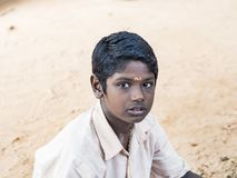 Portrait of a child teenager boy with sad expression. Loneliness poverty concept. PUDUCHERRY, INDIA - DECEMBER Circa, 2018. Portrait of unidentified child stock images