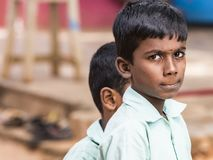 Portrait of a child teenager boy with sad expression. Loneliness poverty concept. PUDUCHERRY, INDIA - DECEMBER Circa, 2018. Portrait of unidentified child royalty free stock photos