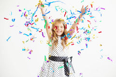 Portrait of a child throws up multi-colored tinsel and confetti Stock Images