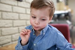 Child with toothpick Stock Images