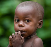 Portrait of a child from a tribe of pygmies. Stock Images