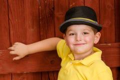 Portrait of child wearing fedora hat Stock Photo