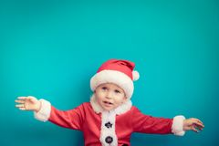 Portrait of child wearing Santa Claus costume royalty free stock photography