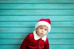 Portrait of child wearing Santa Claus costume stock photos