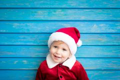 Portrait of child wearing Santa Claus costume stock photo