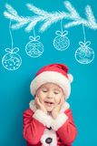 Portrait of child wearing Santa Claus costume royalty free stock image