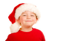 Portrait of child wearing Santa hat Stock Photo