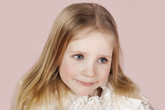 Portrait of the child in a white dress Stock Photography