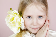 Portrait of the child in a white dress with a flower in hair Royalty Free Stock Photography
