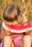 Portrait of the child who eats sweet water-melon Royalty Free Stock Photo