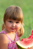 Portrait of the child who eats a sweet water-melon Stock Images
