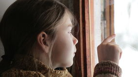 Portrait of child in the window. The boy face close up child through the glass. stock video