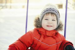 Portrait of a child in winter clothes Stock Photo