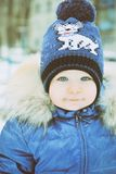 Portrait of a child in winter clothes Stock Image