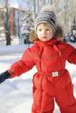 Portrait of a child in winter clothes, a walk through a winter park, Stock Photography