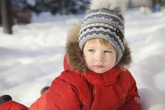Portrait of a child in winter clothes, a walk through a winter park, Royalty Free Stock Photos