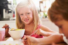 Portrait Of Children Eating Breakfast At Kitchen Table Royalty Free Stock Image