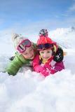 Portrait of children enjoying the snow Stock Image