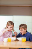 Portrait of children having breakfast. In a kitchen Stock Image