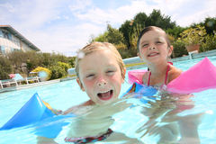 Portrait of children having fun in swimming pool Royalty Free Stock Photo