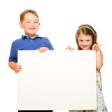 Portrait of children holding blank sign Royalty Free Stock Image