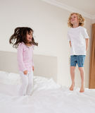 Portrait of children jumping Stock Image