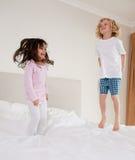 Portrait of children jumping Stock Image