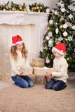 Portrait of children with New Year gifts Christmas. The portrait of children with New Year gifts Christmas Royalty Free Stock Photos