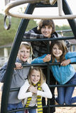 Portrait of children on playground equipment Stock Image