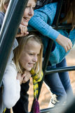 Portrait of children on playground equipment Royalty Free Stock Photo