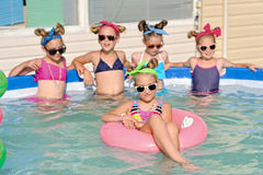 Portrait of children. On the pool in summer royalty free stock photography