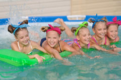 Portrait of children. On the pool in summer stock image