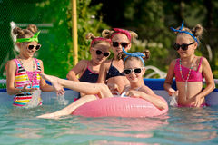 Portrait of children. On the pool in summer royalty free stock images