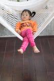 Portrait of children realxing in cradle Stock Image