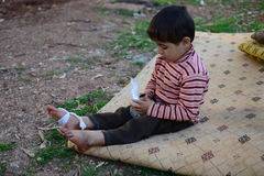 Portrait of children refugee. During civil war in Syria quite 8 milions people left their homes. Quite a half of them are children. More tham 2 milions people Stock Photography