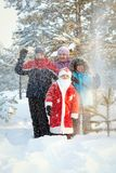 Portrait of children and Santa in winter forest Stock Photos