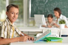 Portrait of children at school in the classroom royalty free stock photos