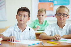Portrait of children in shool. At the lesson Royalty Free Stock Image