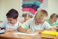 Portrait of children in shool. At the lesson Stock Photo