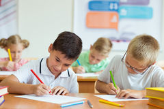 Portrait of children in shool. At the lesson Royalty Free Stock Images