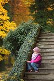 Portrait of children sitting on the stairs Stock Images
