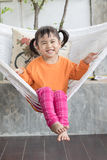 Portrait of children toothy smiling and relaxing in clothes crad. Le at home living terrace Royalty Free Stock Photos