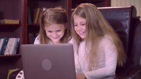 Portrait children use computer indoors stock video footage