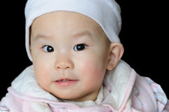 Portrait of a chinese baby under black background Royalty Free Stock Photo