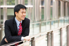 Portrait Of Chinese Businessman Outside Office Stock Photo