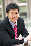 Portrait Of Chinese Businessman Outside Office Royalty Free Stock Image