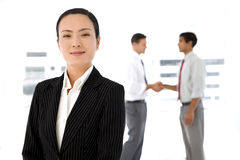 Portrait of a chinese executive woman with partners in background Royalty Free Stock Image